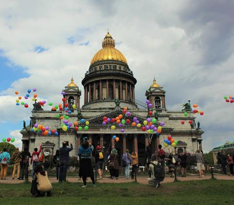 LGBT rights advocates in Russia release symbolic LGBT balloons into the sky