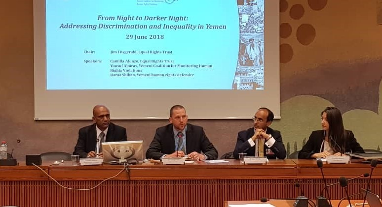 A group of experts on a panel at the United Nations in Geneva.