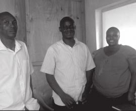 John Paul Makere (centre) with another worker from the Centre, David Mukunda and client, Jane Mulanda.