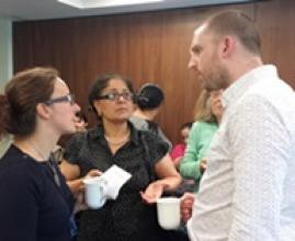 Jim Fitzgerald Head of Advocacy talks with Roma at a training session