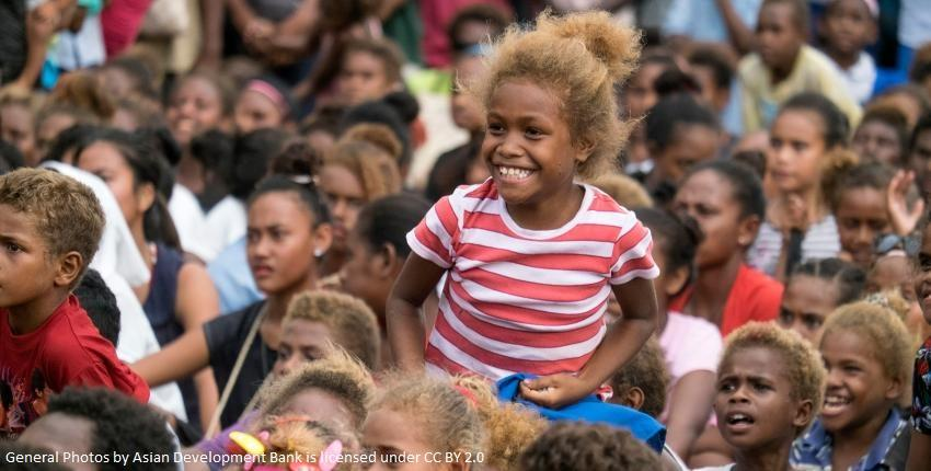 Solomon Islander girl on shoulders